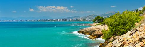 View of summer Spain in sunny weather. Panoramic seascape of Mediterranean sea,and seaside resort in high summer stock image