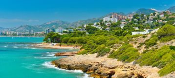 View of summer Spain in sunny weather. Panoramic seascape of Mediterranean sea,and seaside resort in high summer royalty free stock image