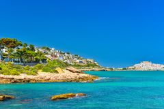 View of summer Spain in sunny weather. Panoramic seascape of Mediterranean sea,and seaside resort in high summer stock photography