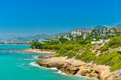 View of summer Spain in sunny weather. Seascape of Mediterranean sea,and seaside resort in high summer royalty free stock images