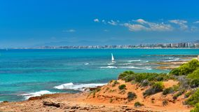 View of summer Spain in sunny weather. Seascape of Mediterranean sea,and seaside resort in high summer royalty free stock image