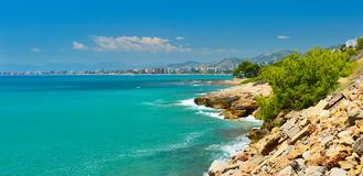 View of summer Spain in sunny weather. Panoramic seascape of Mediterranean sea,and seaside resort in high summer royalty free stock photos