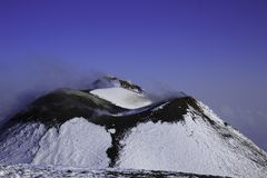 Etna Volcan-Summit crater in snowy landscape royalty free stock photography