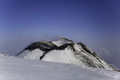 Etna Volcan-Summit crater in snowy landscape royalty free stock image