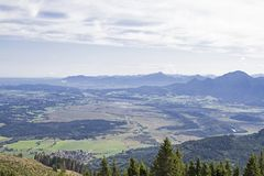 Views of the Murnau Moor. View from the summit of the Hintere Hoernle to Murnau Moor in the Bavarian foothills of the Alps stock photos