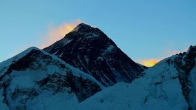 Summit of Mount Everest just before sunrise. View of the summit of Mount Everest in Nepal, also known as Sagarmatha or Chomolungma, from the slope of Mount Kala stock footage