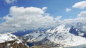 View from the summit of Sass Pordoi to the valley in the Dolomites stock video