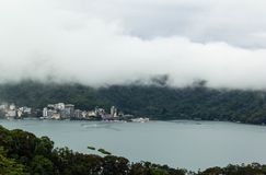 View of Sun Moon Lake. With Ita Thao village covered by white mist stock photography