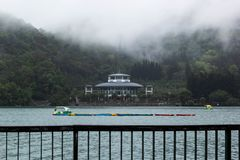 View of Sun Moon Lake. With the ropeway station building and paddle boats in the lake stock images