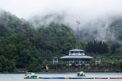 View of Sun Moon Lake. With the ropeway station building and paddle boats in the lake royalty free stock photos
