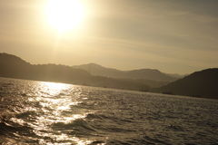View of sun rise from the boat. Sun rising in the in the ocean Royalty Free Stock Photography