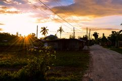 Stunning view of the sun setting over rural life on the island of Cebu, Philippines. View of the sun setting over rural life on the island of Cebu, Philippines Royalty Free Stock Photography