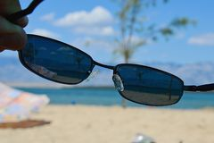 View on sunny beach through dioptric sunglasses with UV 400 filter Royalty Free Stock Images