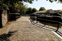 Cobbled Towpath near Wigan Pier. The view of the sunny cobbled towpath alonge the Leeds Liverpool canal Royalty Free Stock Images