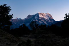 View of sunrise on Chaukhamba peaks of Garhwal himalayas of uttrakhand from Deoria Tal camping site. Mystical Chaukhamba peaks of Garhwal Himalayas during dawn royalty free stock photography