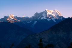 View of sunrise  on Chaukhamba peaks of Garhwal himalayas of uttrakhand from Deoria Tal camping site. Royalty Free Stock Images