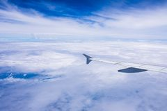 View the sunrise and clouds from the flight window royalty free stock photo
