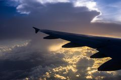 View the sunrise and clouds from the flight window royalty free stock photos