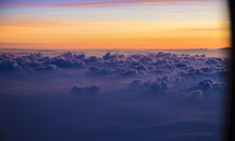 View of a sunrise full of color. From the window of an airplane royalty free stock image
