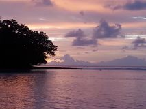View of the sunrise in Diego Garcia. This photo features a nice sunrise on the Indian Ocean Stock Photo