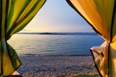 Sunrise on Maloe More. Lake Baikal. Russia. View of sunrise on Maloe More from the camping tent . Lake Baikal in the morning. Russia Stock Photography