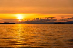 Sunrise on Maloe More. Lake Baikal. Russia. View of sunrise on Maloe More. Lake Baikal in the morning. Russia Royalty Free Stock Images