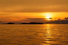 Sunrise on Maloe More. Lake Baikal. Russia. View of sunrise on Maloe More. Lake Baikal in the morning. Russia Royalty Free Stock Photo