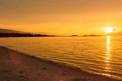 Sunrise on Maloe More. Lake Baikal. Russia. View of sunrise on Maloe More. Lake Baikal in the morning. Russia Royalty Free Stock Image