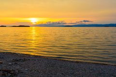 Sunrise on Maloe More. Lake Baikal. Russia. View of sunrise on Maloe More. Lake Baikal in the morning. Russia Royalty Free Stock Photos