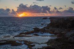 View of the sunrise over the ocean from Cape. View of the sunrise from the Sun Cape north point on the island of Barbados over the ocean Stock Photo