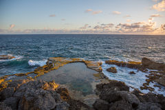 View of the sunrise over the ocean from Cape. View of the sunrise from the Sun Cape north point on the island of Barbados over the ocean Royalty Free Stock Photography