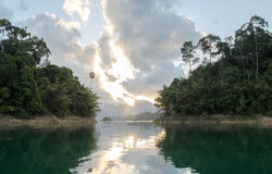 View of Sunrise with Reflection Between Two Island in Khao Sok National Park at Suratthani,Thailand from The Boat Royalty Free Stock Photography
