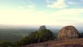 View of sunrise of Sigiriya rock from Pidurangala rock, Sri Lanka stock footage