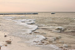View of the sunset of the Baltic Sea in the winter. Stock Photo