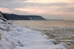 View of the sunset of the Baltic Sea in the winter. Royalty Free Stock Image