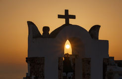 View on sunset through belfry in Oia Royalty Free Stock Photography