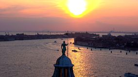 The view of the sunset from the bell tower of the Cathedral of San Giorgio Maggiore. Venice, Italy. The view of the sunset from the bell tower of the Cathedral stock video
