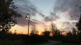 The view of the sunset in the city Park stock video footage