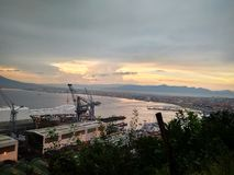 View of the sunset in the Gulf of Naples Mount Vesuvius and the port royalty free stock photo