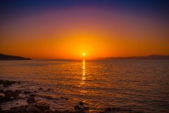 View on sunset in a harbor of small town Postira - Croatia. View on sunset in a harbor of small town Postira - Dalmatia, Croatia Stock Photography