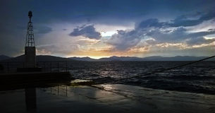View of a sunset in a harbour in the Mediterranean sea Royalty Free Stock Photos