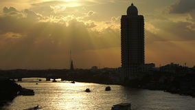 View of sunset over chaophraya river bangkok Thanlabd ; quick motion. Clip View of sunset over chaophraya river bangkok Thanlabd ; quick motion stock video footage