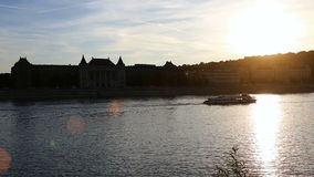 View of sunset over Danube at Budapest from wharf. Sunset over Budapest cityscape on river Danube stock footage
