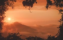 Sunset over the mountains by Minca in Colombia Stock Photos