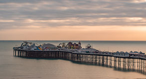 View of a sunset on the pier in Brighton, Southern England. View of a sunset on the pier in Brighton and Hove, Southern England Stock Photo