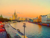 View of the sunset on the river, a residential skyscraper on Kotelnicheskaya Embankment, Moscow River, Bolshoy Ustinsky bridge. View of the sunset on the river royalty free stock photography