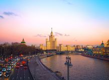 View of the sunset on the river, a residential skyscraper on Kotelnicheskaya Embankment, Moscow River, Bolshoy Ustinsky bridge. Mo. Scow, Russia Royalty Free Stock Images