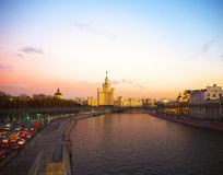 View of the sunset on the river, a residential skyscraper on Kotelnicheskaya Embankment, river, Bolshoy Ustinsky bridge, Moscow. View of the sunset on the river royalty free stock image