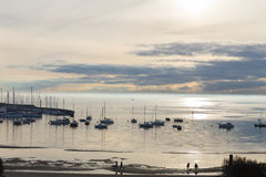 View at sunset of sea fog and yachts. Sea view with fog and incoming boat in Hampton Australia Stock Photos