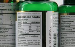 Vitamin Bottles. View of supplement facts on the back of vitamin bottles Stock Image